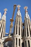 Gaudi`s Sagrada Familia in Barcelona, true modern towers, one of them a crane. Three of the many towers of the Sagrada Familia in Barcelona, Spain, the famous Royalty Free Stock Photo