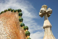 Gaudi sculptures. Low angle view of decorative Antoni Gaudi rooftop sculptures with cloudscape background, Barcelona, Spain Stock Photo