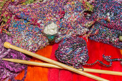 Gaudy wools and knitting needles Royalty Free Stock Photography