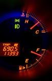Gauge. A modern car dashboard with illuminated gauges at night Stock Image