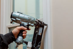Gauge Finish Nailer man nailed slats custom house building contractor up a wall section for luxury. Custom house Royalty Free Stock Images