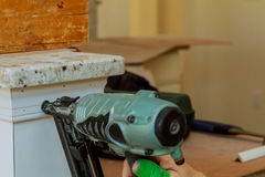 Gauge Finish Nailer man nailed slats custom house building contractor up a wall section for luxury Stock Images