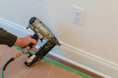 Gauge Finish Nailer man nailed slats custom house building contractor up a wall section for luxury Stock Photos