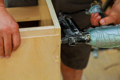 Gauge Finish Nailer man nailed slats customkitchen, cabinet, adjustment, assembling contractor Stock Image