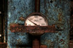 Gauge on hydraulic press. A close up of a gauge on a hydraulic press Royalty Free Stock Image