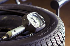 Gauge pressure meter on a tire Stock Photo