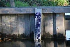 Gauge rod in the water to measure water heigth which is almost 6 meters below sea level. Gauge rod in the water to measure water heigth which is almost 6 meters stock images