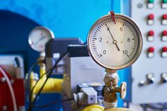 A gauge showing the gas pressure is installed on the pipeline. Industrial background. stock photo