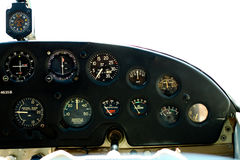 Gauges in Cessna cockpit. Gauges in the cockpit of a Cessna 182 aircraft.  Background is white which is really the blown-out sky Stock Photos
