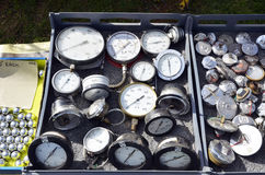 Gauges. Collection of old gauges and fuel caps at a swap meet Stock Photography