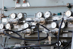 Gauges and Dials. That control and feed air supply to scuba tanks on a naval vessel Stock Image