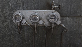 Gauges. A set of gauges on a wall in an industry warehouse Stock Images