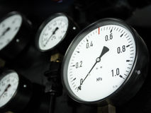 Gauges of the steam locomotive. Pressure gauges in the old steam locomotive. Shallow depth of field Royalty Free Stock Image