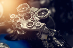 Gauges of vintage retro motorcycle on dark background Stock Photos