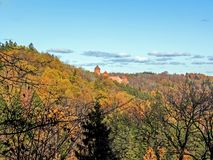 Gauja valley slopes covered under colorful autumn trees and Turaida medieval red stone brick castle stock photography