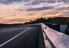 Gaurdrail de la puesta del sol fotos de archivo libres de regalías