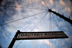 Gautrey Road sign against telephone wires and sky Stock Photo
