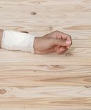 Gauze bandage the hand contusion. treating patients with hand. With a wrist left, male With gauze is wrapping his injury On a wooden table . select focus front Stock Photo