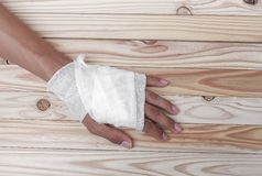 Gauze bandage the hand contusion. treating patients with hand. With a wrist left, male With gauze wrapping his injury On a wooden table . select focus front Royalty Free Stock Photos
