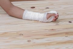 Gauze bandage the hand contusion. treating patients with hand. With a wrist left, male With gauze wrapping his injury On a wooden table . select focus front Royalty Free Stock Images