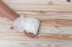 Gauze bandage the hand contusion. treating patients with hand. With a wrist left, male With gauze wrapping his injury On a wooden table . select focus front Royalty Free Stock Photo