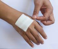 Gauze bandage the hand Stock Photos