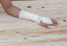 Gauze bandage the hand wound. treating patients with hand. Gauze bandage the hand contusion. treating patients with hand with a wrist left, male With gauze Stock Image
