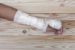 Gauze bandage the hand wound. treating patients with hand. Gauze bandage the hand contusion. treating patients with hand with a wrist left, male With gauze Stock Photography