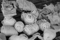 Gauze Bandages wraps - 1522. Gauze, bandages, and wraps on wood table in black and white Stock Image