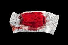 Gauze with blood. On black background Stock Photography