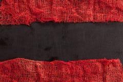 Gauze with blood. On black background Royalty Free Stock Image