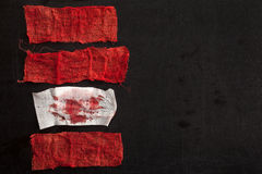Gauze with blood. On black background Royalty Free Stock Images