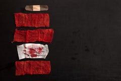 Gauze with blood. On black background Stock Photo