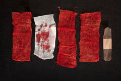 Gauze with blood. On black background Royalty Free Stock Photo