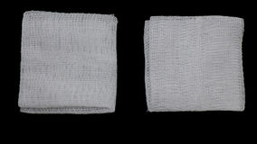 Gauze pads on the black background Royalty Free Stock Photos