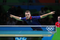 Gauzy Simon playing table tennis at the Olympic Games in Rio 2016. Gauzy Simon from France playing table tennis at the Olympic Games in Rio 2016 Royalty Free Stock Photo