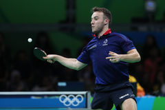Gauzy Simon playing table tennis at the Olympic Games in Rio 2016. Gauzy Simon from France playing table tennis at the Olympic Games in Rio 2016 Royalty Free Stock Photos