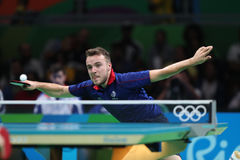 Gauzy Simon playing table tennis at the Olympic Games in Rio 2016. Gauzy Simon from France playing table tennis at the Olympic Games in Rio 2016 Stock Photography