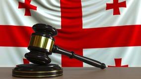 Gavel και φραγμός δικαστή ενάντια στη σημαία της Γεωργίας Της Γεωργίας εννοιολογική ζωτικότητα δικαστηρίων απεικόνιση αποθεμάτων