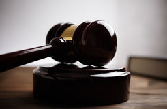Gavel. Juridical concept with hammer and lawbook, selective focus ,toned royalty free stock photos