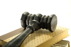 Gavel. A Gavel on Top of Books - Legal Related Royalty Free Stock Photo