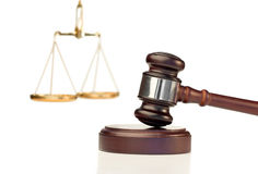 Gavel in action and scale of justice. On a white background Royalty Free Stock Images