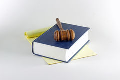 Gavel atop Legal Pad and Book Stock Images