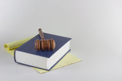 Gavel atop Legal Pad and Book Royalty Free Stock Photo