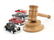 Gavel auction and cars. Gavel auction with antiques cars Royalty Free Stock Image