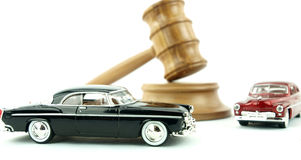 Gavel auction and cars. Gavel auction with antiques cars Royalty Free Stock Images
