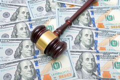 Gavel on a background of U.S. dollars Royalty Free Stock Image