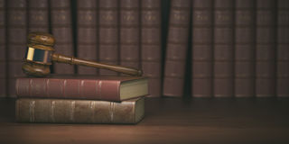 Gavel on the background of vintage lawyer books. Concept of law Stock Photography