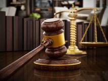 Gavel and balanced scale on wooden table. 3D illustration.  Royalty Free Stock Images