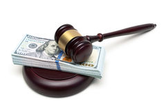 Gavel and a big wad of money isolated on white background Royalty Free Stock Images